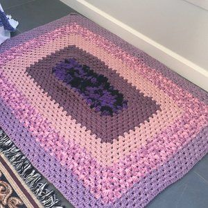 Purple knitted floor mat